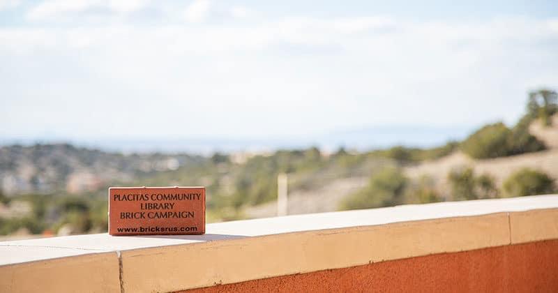 """Brick inscribed """"Placitas Community Library Brick Campaign"""""""